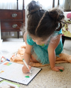 Here's Lucy coloring the game board.
